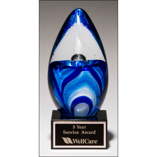 Teardrop-shaped art glass award on black glass base